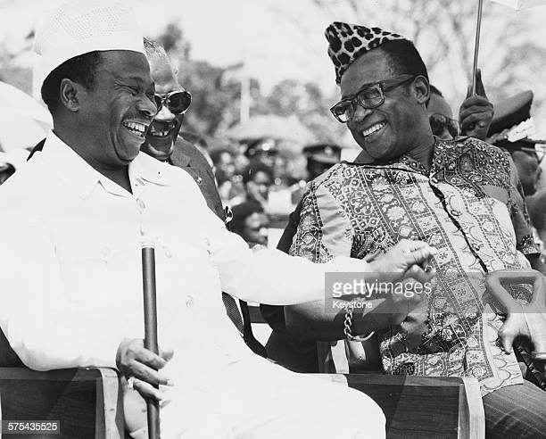 Liberian President William Tolbert sharing a joke with President Mobutu Sese Seko of Zaire as they watch a military parade in celebration of the 5th...