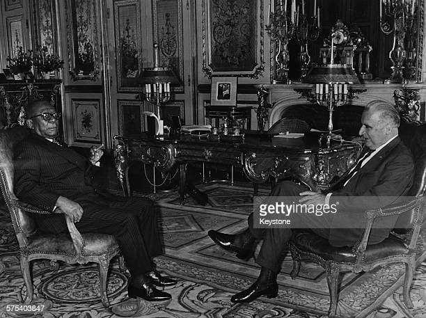 Liberian President William Tubman talking to French Prime Minister Georges Pompidou at a meeting in the Elysee Palace Paris circa 1970