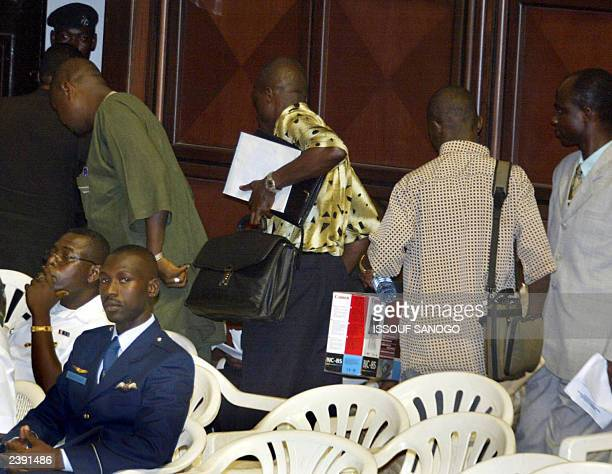 Liberian rebel groups leave the hall as Liberian President Charles Taylor stands to speak in the International Conference Centre Accra 04 June 2003...