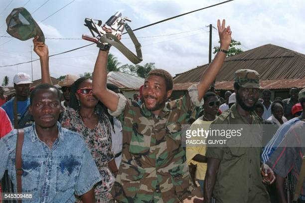 Liberian rebel leader Charles Taylor celebrates with troops on July 21 1990 in Roberts Field an airport outside Monrovia after taking over this...