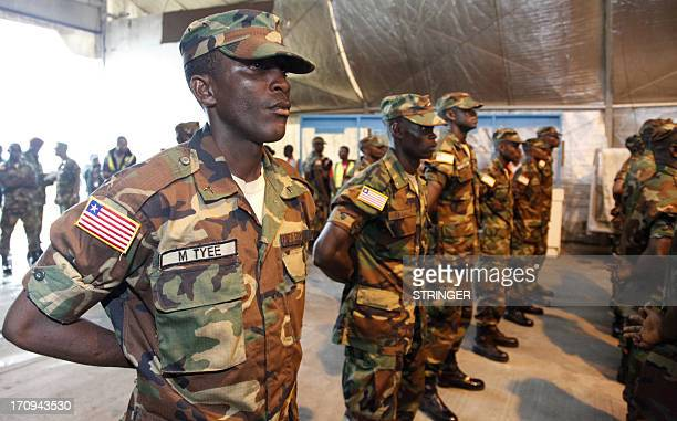 Liberian troops stand in rows at Roberts International Airport in Monrovia before embarking on a peacekeeping mission to Mali to join the Africanled...