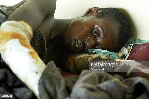 Liberian who had been bound and suffer from gangrenous limbs is left to die in a separate room at a beer factory used as a medical clinic August 10...