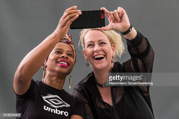 Liberian writer H J Golakai and Icelandic crime-writer and playwright Lilja Sigurdardottir attends a photocall during the annual Edinburgh...