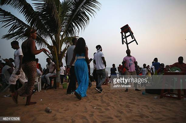 """Liberians socialize at sunset on """"Miami Beach"""" on January 25, 2015 in Monrovia, Liberia. With Ebola cases now in single digits nationwide, many..."""