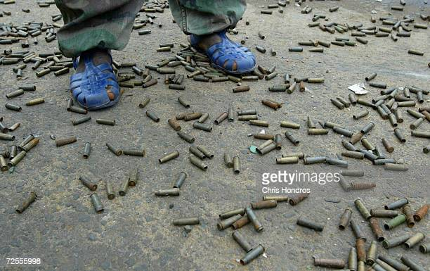 Liberians United for Reconciliation and Democracy stands among hundreds of shell casings August 6 2003 in Monrovia Liberia LURD rebels still hold...