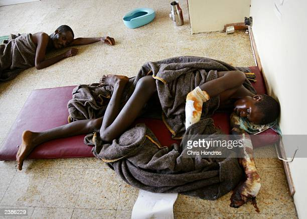 Liberians who had been bound and suffer from gangrenous limbs are left to die in a separate room at a beer factory used as a medical clinic August 10...