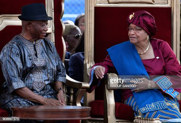 Liberia's outgoing President Ellen Johnson Sirleaf and Vice President Joseph Boakai attend the swearingin ceremony of Liberia's presidentelect on...
