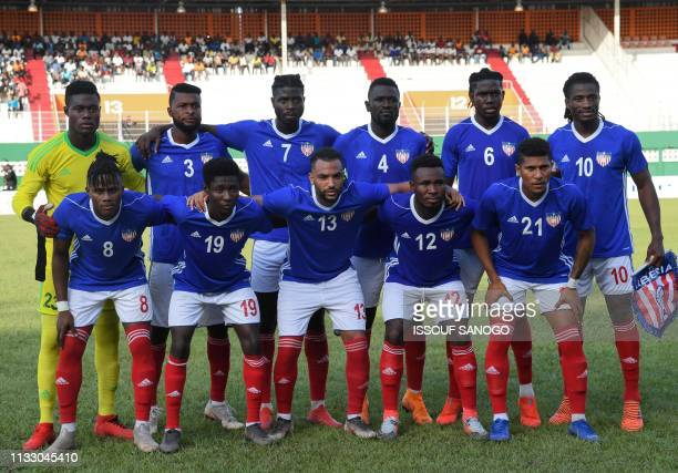 Liberia's players pose for a team photo ahead of a friendly football match between Ivory Coast and Liberia on March 26 2019 at the Felix...