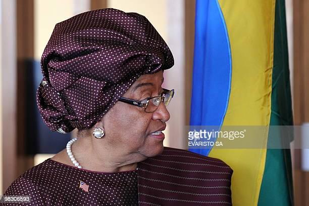Liberia's President Ellen Johnson Sirleaf speaks with Brazil's President Luiz Inacio Lula da Silva during a meeting at Itamataty Palace in Brasilia...