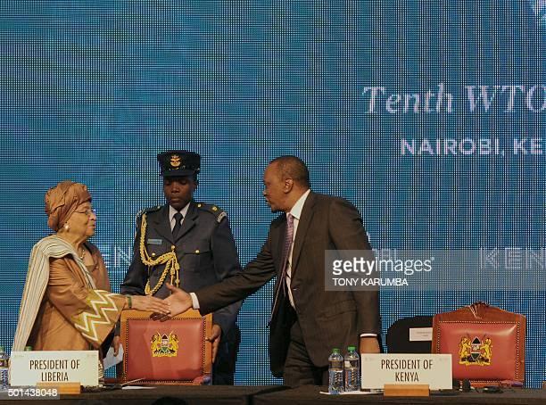 Liberia's President Ellen JohnsonSirleaf shakes hands with her Kenyan counterpart Uhuru Kenyatta on December 15 2015 at the official opening of the...