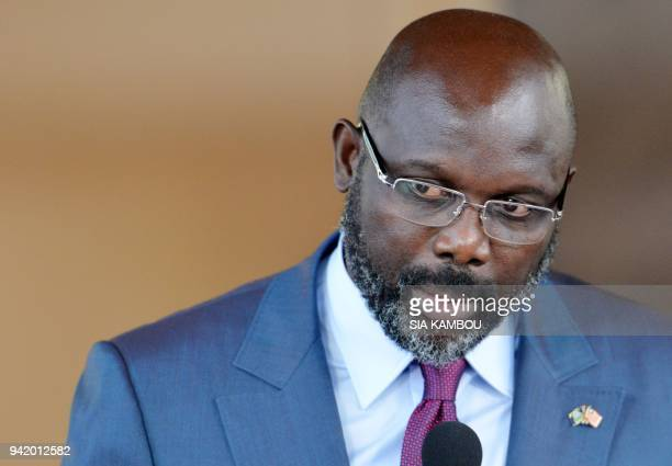 Liberia's President George Weah addresses a press conference with the Ivorian President following a meeting at the Presidential Palace in Abidjan on...
