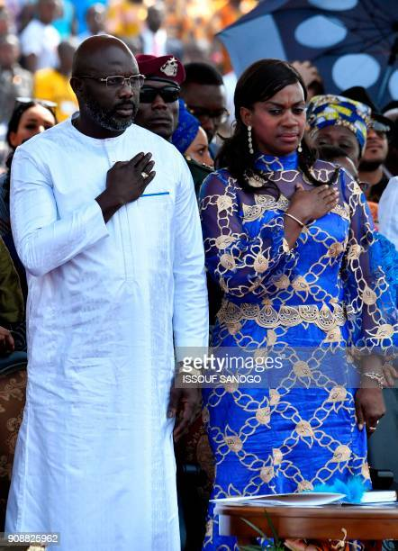 Liberia's presidentelect and former football star George Weah and his wife Clar Weah attend his swearingin ceremony on January 22 2018 in Monrovia To...