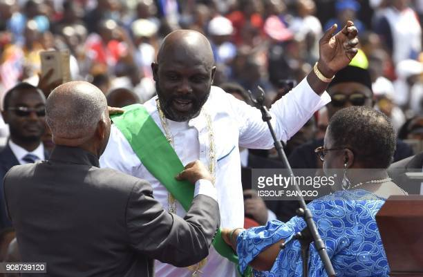 Liberia's Presidentelect and former football star George Weah attends his swearingin ceremony on January 22 2018 in Monrovia To the cheers of a crowd...