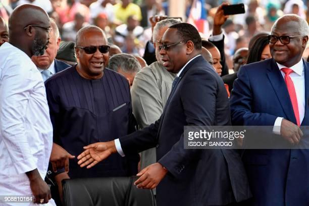Liberia's presidentelect and former football star George Weah Ghana's former President John Dramani Mahama Senegal's President Macky Sall and Sierra...