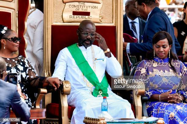 Liberia's Presidentelect and former football star George Weah his wife Clar Weah and the country's new VicePresident Jewel Taylor attend Weah's...