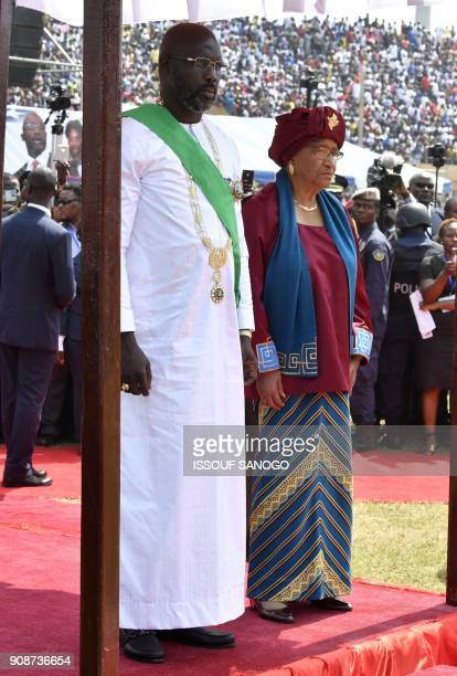 Liberia's Presidentelect and former football star George Weah stands by former President Ellen Johnson Sirleaf after he was swornin on January 22...