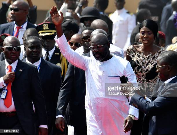 Liberia's presidentelect and former football star George Weah waves as he arrives for his swearingin ceremony on January 22 2018 in Monrovia To the...