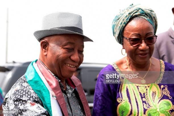 Liberia's vice president and candidate in the upcoming presidential election Joseph Nyumah Boakai and mayor of Monrovia Clara Doe Mvogo arrive to a...
