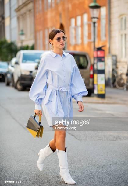 Liberta Haxhikadriu is seen wearing blue belted dress white cowboy boots outside Helmstedt during Copenhagen Fashion Week Spring/Summer 2020 on...