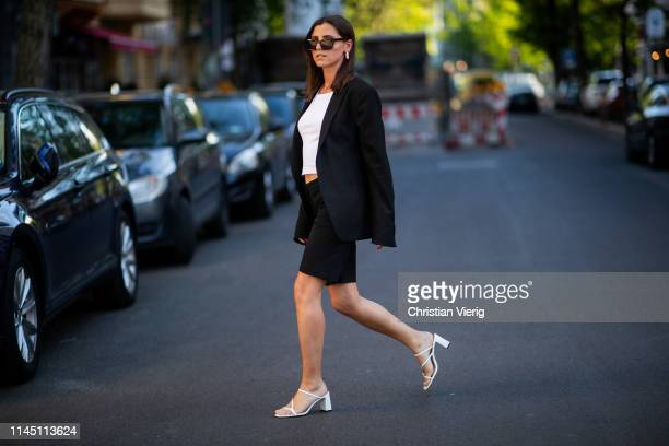 Liberta Haxhikadriu is seen wearing white tshirt, black blazer, black shorts, white sandals on April 25, 2019 in Berlin, Germany.