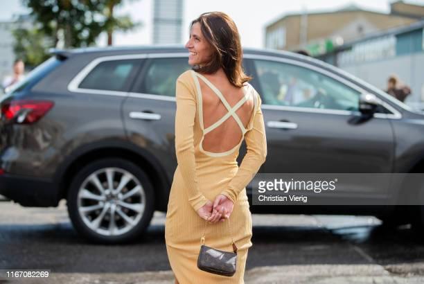 Liberta Haxhikadriu seen wearing beige backless dress outside Baum und Pferdgarten during Copenhagen Fashion Week Spring/Summer 2020 on August 08,...