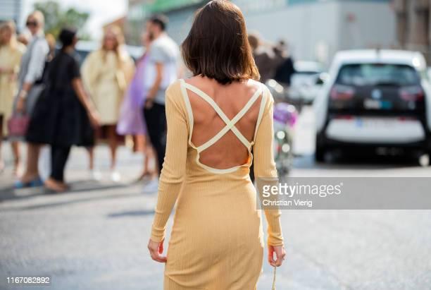 Liberta Haxhikadriu seen wearing beige backless dress outside Baum und Pferdgarten during Copenhagen Fashion Week Spring/Summer 2020 on August 08...