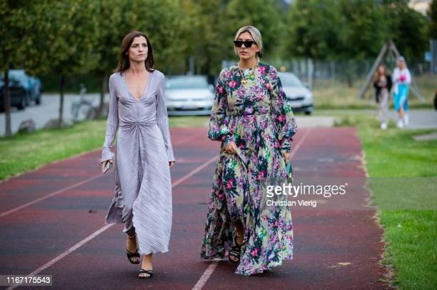 Liberta Haxhikadriu wearing dress and Aylin König wearing dress with floral print is seen outside Rotate during Copenhagen Fashion Week Spring/Summer...