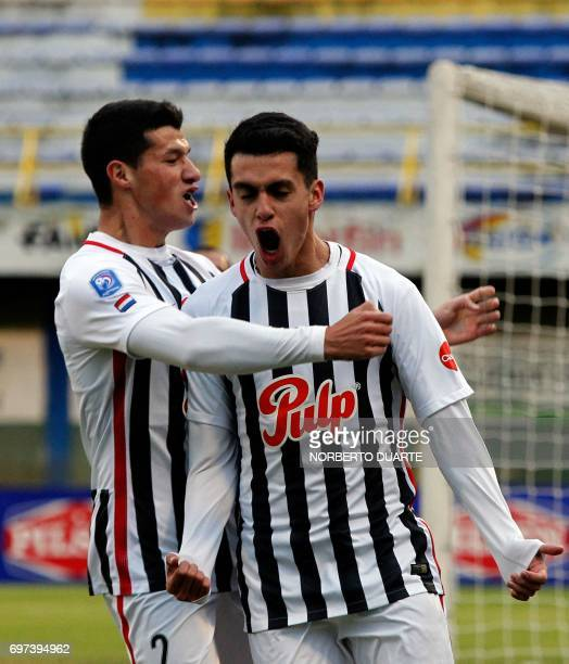 Libertad's footballer Jesus Medina celebrates with teammate Alan Benitez after scoring against Sportivo Luqueno during their Paraguayan Apertura...