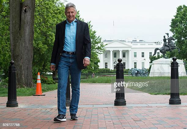 Libertarian Party presidential candidate Gary Johnson walks in Lafayette Park across from the White House during an interview with AFP in Washington,...