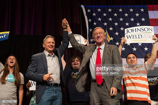 Libertarian presidential candidate Gary Johnson and vice-presidential candidate William Weld wave to supporters at a rally on September 10, 2016 in...