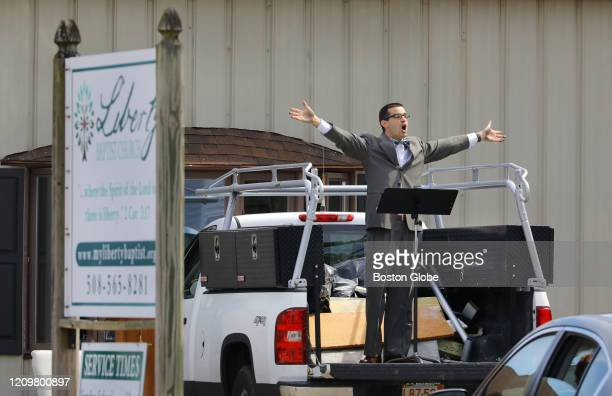 Liberty Baptist Church Pastor Adam Riveiro delivers his sermon from the back of a pickup truck during a drivein Easter service in the South Easton...