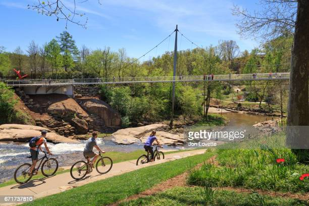 liberty bridge with bikers on path - greenville south carolina stock pictures, royalty-free photos & images