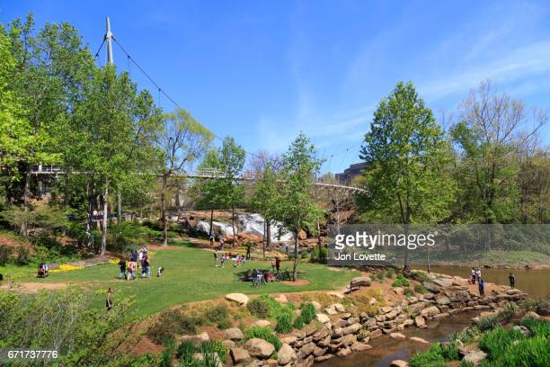 liberty bridge with people enjoying park - greenville south carolina stock pictures, royalty-free photos & images