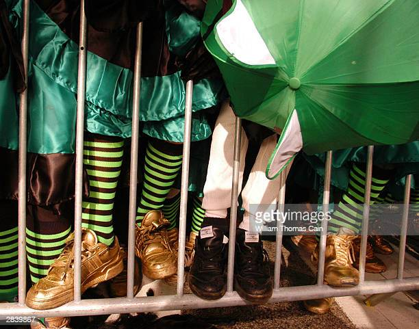 Liberty Comic Club members feet are seen on a guard rail during the 103rd New Year's Day Mummer's Parade Mummer's Parade January 1 2004 in...