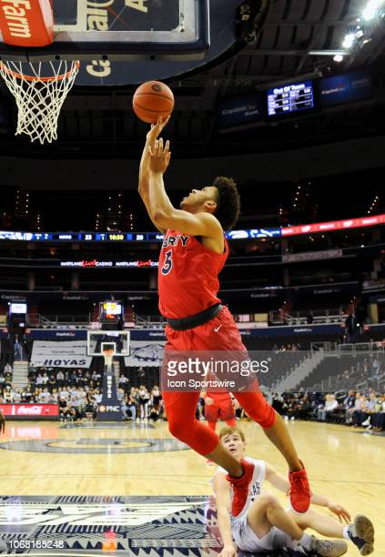 Liberty Flames forward Keenan Gumbs scores in the first half against Georgetown Hoyas guard Greg Malinowski on December 3 at the Capital One Arena in...