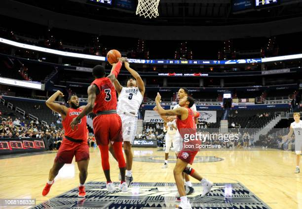 Liberty Flames guard Lovell Cabbil Jr fouls Georgetown Hoyas guard James Akinjo in the second half on December 3 at the Capital One Arena in...