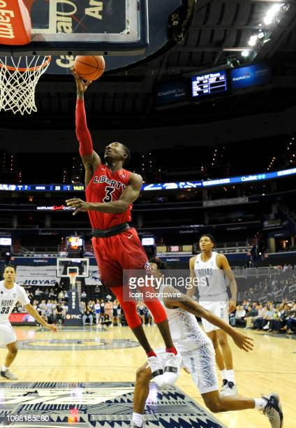 Liberty Flames guard Lovell Cabbil Jr scores in the first half against Georgetown Hoyas guard James Akinjo on December 3 at the Capital One Arena in...
