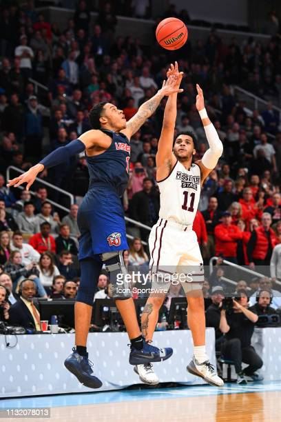 Liberty guard Caleb Homesley fouls Mississippi State guard Quinndary Weatherspoon on a three point shot in the final minute of the game between the...