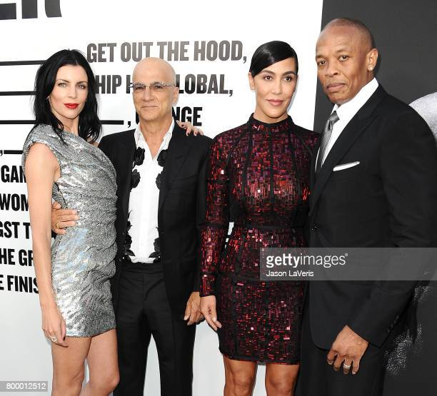 Liberty Ross Jimmy Iovine Nicole Young and Dr Dre attend the premiere of 'The Defiant Ones' at Paramount Theatre on June 22 2017 in Hollywood...