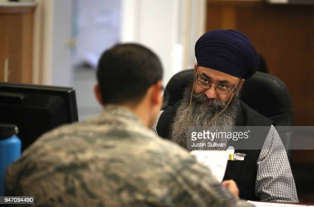 Liberty Tax Service tax specialist Malkeet Singh helps a client do his taxes on April 16 2018 in Oakland California Taxpayers who have procrastinated...
