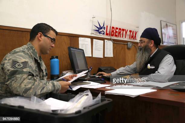 Liberty Tax Service tax specialist Malkeet Singh helps Ikaika San Nicolas do his taxes on April 16 2018 in Oakland California Taxpayers who have...