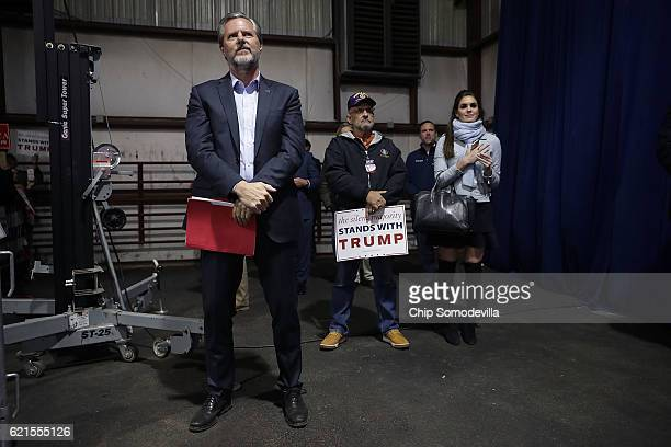 Liberty University President Jerry Falwell Jr and campaign spokesperson Hope Hicks listen to Republican presidential nominee Donald Trump during a...