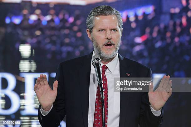 Liberty University President Jerry Falwell Jr introduces Republican presidential candidate Donald Trump with a sports jersey after he delivered the...