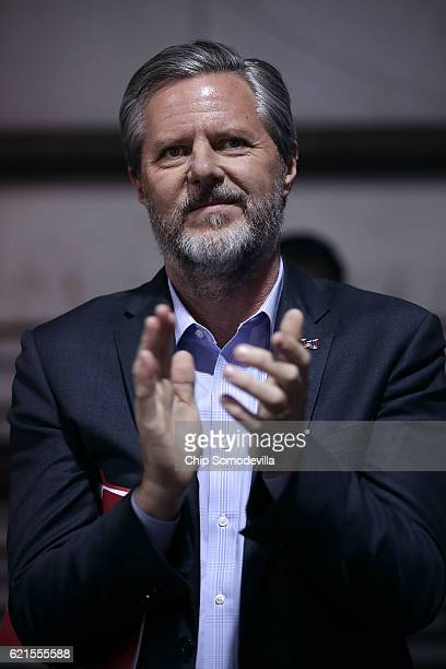 Liberty University President Jerry Falwell Jr listens to Republican presidential nominee Donald Trump during a campaign rally at the Loudoun County...