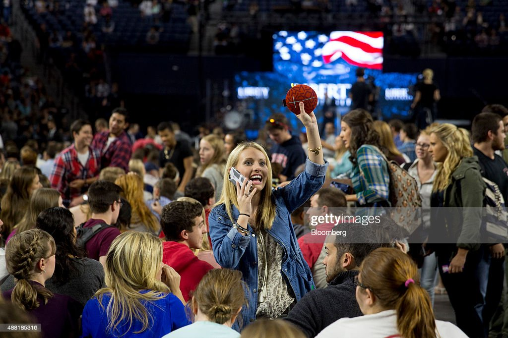 Liberty University student Allison Carnes waves to a friend before Senator Bernie Sanders, an independent from Vermont and 2016 Democratic presidential candidate, not pictured, speaks at a Liberty University Convocation in Lynchburg, Virginia, U.S., on Monday, Sept. 14, 2015. Sanders now leads his Democratic rival former secretary of state Hillary Clinton by double digits in Iowa and New Hampshire, the first two states in where votes will be cast in 2016 to decide the party's presidential nominee. Photographer: Andrew Harrer/Bloomberg via Getty Images
