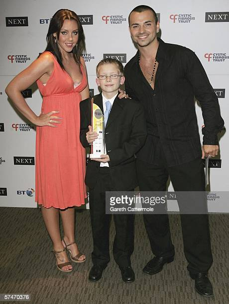 Liberty X singer Michelle Heaton Connor Coffey and Andy ScottLee pose in the awards room at the Cystic Fibrosis Trust Breathing Life Awards on April...