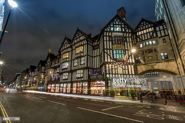 libertys, london at night - christine wehrmeier stock pictures, royalty-free photos & images