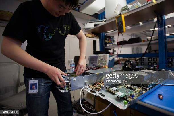Libin Bai an electrical test engineer intern at Facebook Inc puts together a server to be tested at the company's hardware labs in Menlo Park...