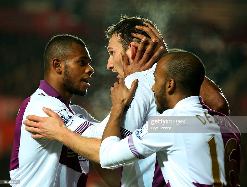Libor Kozak of Aston Villa (C) celebrates as he scores their second goal with Leandro Bacuna (L) and Fabian Delph (R) during the Barclays Premier League match between Southampton and Aston Villa at St Mary's Stadium on December 4, 2013 in Southampton, England.