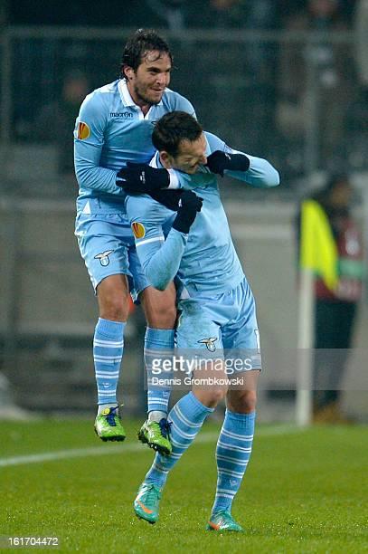 Libor Kozak of Lazio celebrates with teammate Alvaro Gonzalez after scoring his team's second goal during the UEFA Europa League round of 32 first...